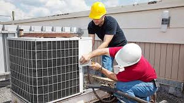 Repair Men fixing AC units