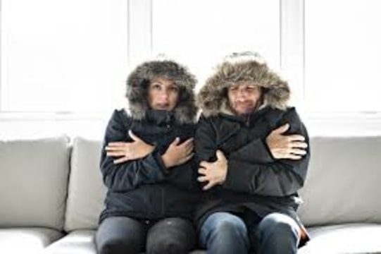 couple cold in their home.